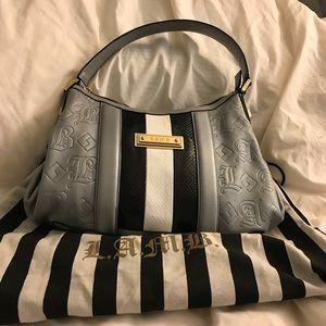Authentic LAMB handbag. Excellent condition.